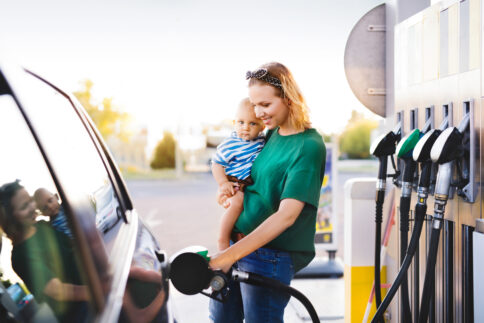 Young,Mother,With,Baby,Boy,At,The,Petrol,Station.